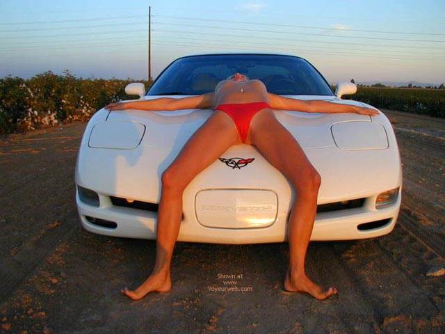 Pic #1 - On Her Back On A Car - Spread Legs , On Her Back On A Car, Legs Spread, Red Bikini Bottom