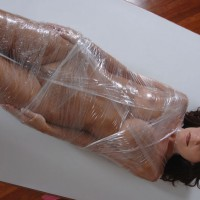 Nude Sexy Brunette Bondage Wrapped In Plastic Wrap Arms To Side - Bondage, Brunette Hair, Long Hair, Trimmed Pussy, Naked Girl, Nude Amateur, Sexy Face