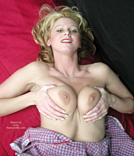blonde tits squeeze boobs