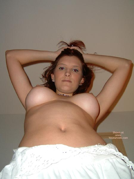 Pic #1 - Huge Boobs - Huge Tits , Huge Boobs, Looking Down Into Camerar, White Skirt, Upward Vertical