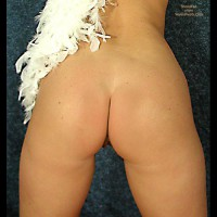TANYA WRAPPED IN WHITE FEATHER