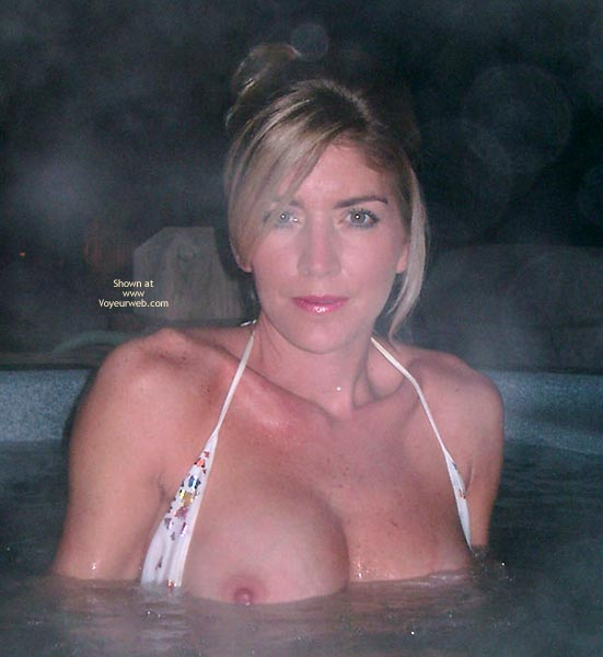 Pic #1 - Flashing In The Hot Tub - Bikini, Looking At The Camera, Flashing In The Hot Tub, Topless In Hot Tub, Looking At Camera, White Bikini, Blonde Bikini Top Opened To Expose Tits, Nipple Flash, Jacuzzi