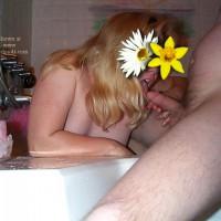 Dirty June gives a Bathroom Blowjob