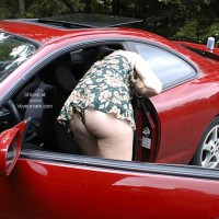 Becky cleaning the car