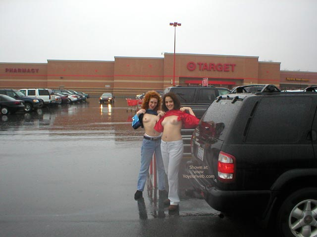 Pic #1 - Rain In The Park Lot - Flashing , Rain In The Park Lot, Two Girl Topless In The Park, Public Flashing, Double Flash In Weather