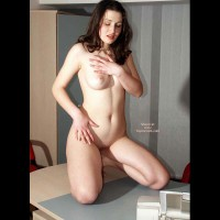 Naked Girl Kneeling On A Desk - Dark Hair, Full Frontal Nudity, Full Nude