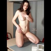 Naked Girl Kneeling On A Desk - Dark Hair, Full Frontal Nudity, Full Nude