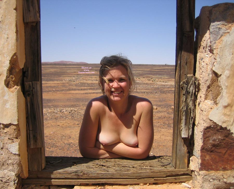 Nude Blond Wife Posing In A Window Sill In Desert