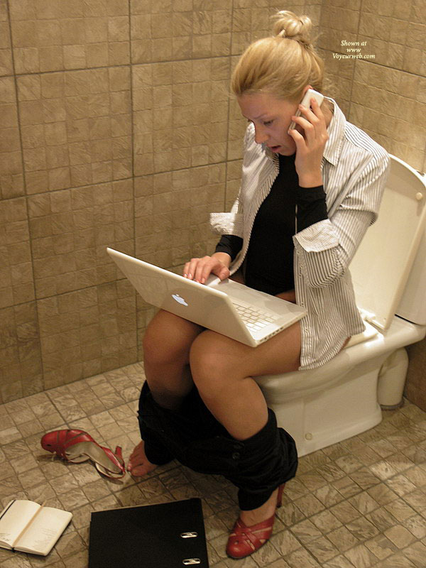 Pic #1 - Using Laptop On Toilet , Red Business Pumps, Black Pants, Multitasking, Multitasking Woman On Toilet, Telecommuting Toilet Shot, Striped Button Down Shirt Black Undershirt, Macbook, Black And White Office Apparel, Ibook, Sitting On Toilet
