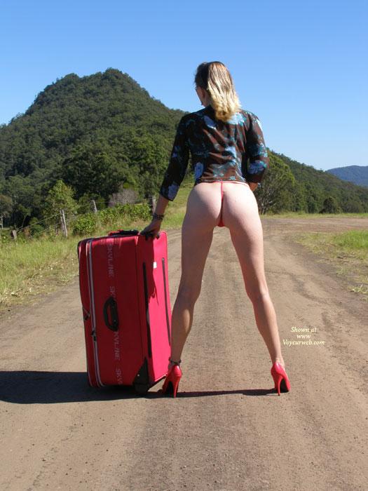 Pic #1 - BOOTY ON THE ROAD - Blonde Hair, Heels, Long Legs , Tall Blonde, Red High Heels, Bond Girl Poster Pose, Black Blue Flower Blouse, Tall Slender, Slender Legs, Rear View Of Legs And Bum, Curvy Legs