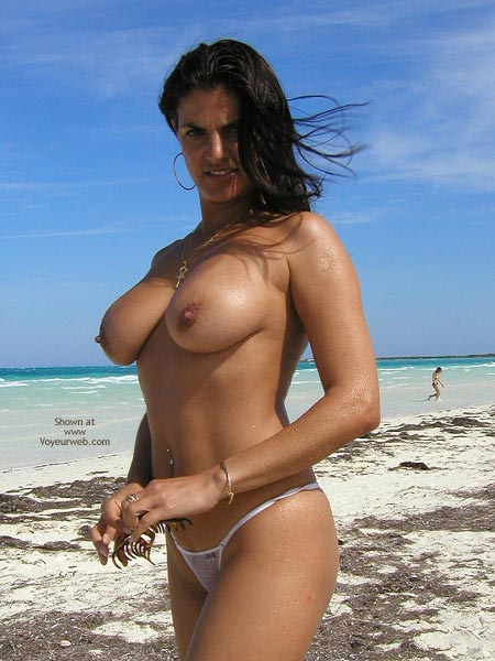 Pic #1 - Topless Girl - Black Hair, Standing, Topless Girl, Beach Voyeur , Topless Girl, Beach Scene, Black Hair, Standing, White String Bikini, Hard Nipples, Navel Adornment