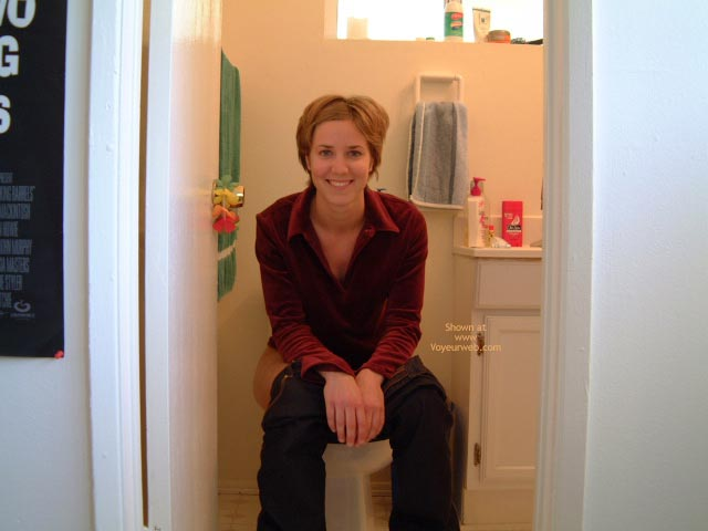 Pic #1 - Sitting On Toilet - Jeans, Looking At The Camera , Sitting On Toilet, Pants Pulled Down, Smiling Into Camera, Short Brunette Hair, Looking At Camera, Blue Jeans, Red Blouse