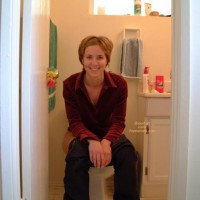 Sitting On Toilet - Jeans, Looking At The Camera