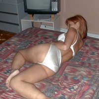 Redhead on The Bed 1