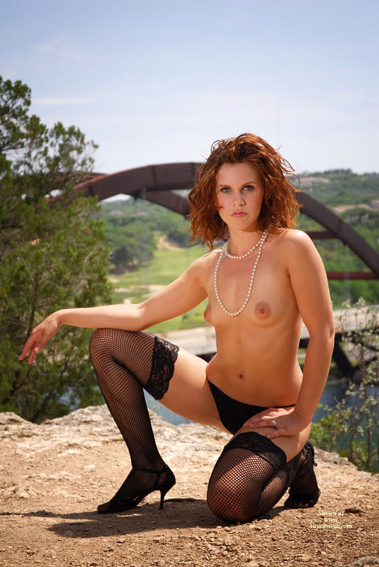 Pic #1 - Redhead On Her Knees Topless Outside - Brunette Hair, Heels, Red Hair, Stockings, Topless , Black Panty, Perky Lips, Pearl Necklace, Large Puffy Aerolas, Fishnet Stockings, Petite Breasts, Bridge In Background, Kneeled Brunette, Classy Pose Oudoors, Fishnet & Heels, Black G String, Topless Outdoor Kneeling On One Knee, White Pearls And Black Panties, Black Fishnet Stockings, Red Hair And Green Eyes Topless, Outdoor Lingerie, Backlit By Sunlight