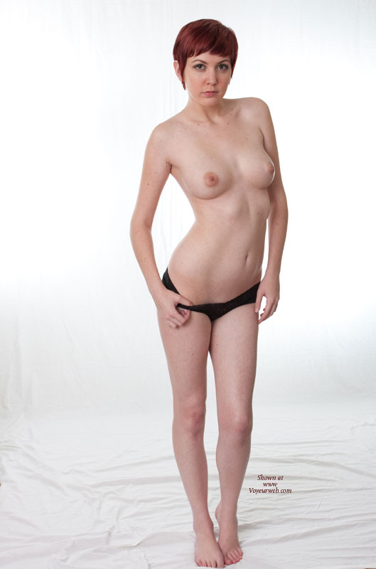 Pic #1 - Sexy Wife Posing Standing Black Panties Only And Bare Feet - Red Hair, Topless , White Background Topless, Arms At Side, Short Red Hair, Left Knee Slightly Bend, Thin Body, Bare Legs Standing On Bare Feet, Short Hair, Tippy Toes, Medium Round Breasts, Puffy Nipples, Serious Look, Topless Indoor Frontal View, White Background