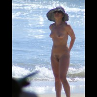 Full Frontal Nudist Babe On The Beach