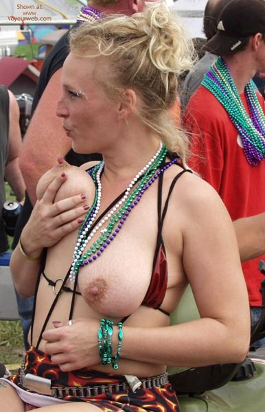 Pic #3 - Biker Rodeo Chick Swallows Her Nipples!