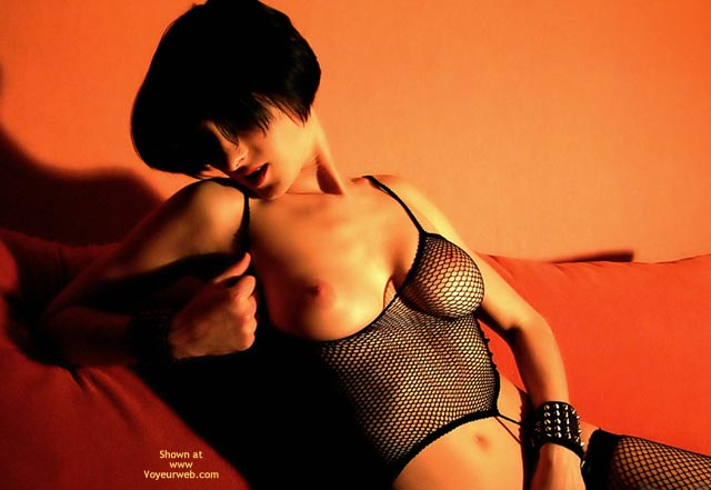 Pic #1 - Girl On A Sofa - Red Lips, Short Hair, Stockings , Girl On A Sofa, Black Fishnet Lingerie, Short Black Hair, Golden Light, Uncovering  Breast, Flawless Skinned Boob