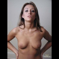 Topless Facial Of A Brunette - Full Frontal Nudity, Small Tits, Sultry Look