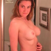 Topless Girl Looking Into Mirror - Brunette Hair, Huge Tits