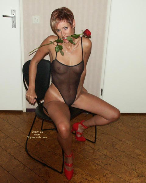 Pic #1 - Girl Sitting On A Chair , Girl Sitting On A Chair, Red Strap Heels, Mesh Body Stocking, Tight Tan Body, Rose In Mouth, Seethrough