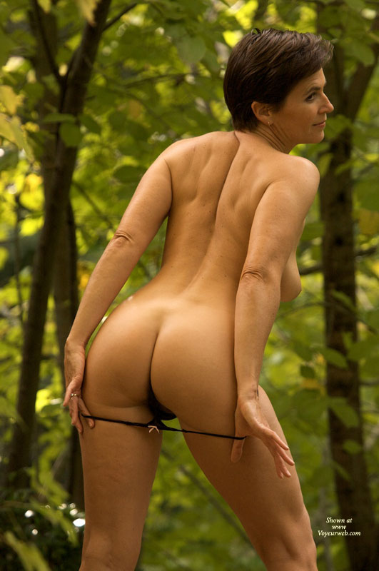 Mature nude in the woods