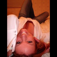 Brunette Laying Across The Floor - Jeans