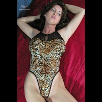Nadine Poses In Leopard Body Suit