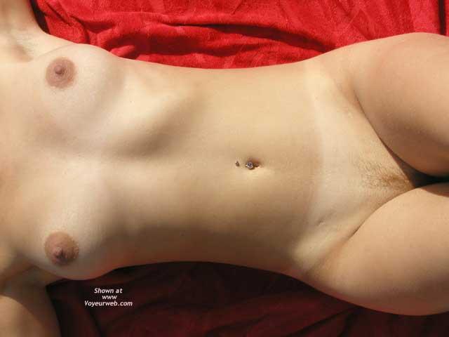 Pic #1 - Landing Strip - Female Torso, Landing Strip , Landing Strip, Female Torso, Girl Lying On Red Fabric, Body Piercing