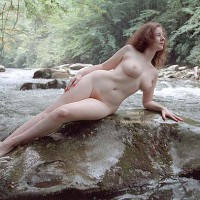 Nude Girl On A Rock - Pale Skin