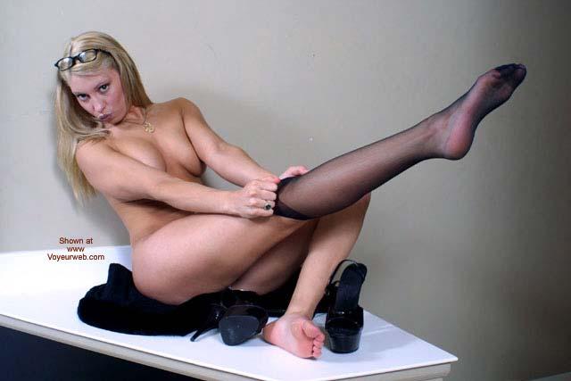 Pic #1 - Girl Dressing Her Stockings - Blonde Hair, Glasses, Heels, Stockings , Girl Dressing Her Stockings, Heels, Blonde, Black Stockings, Stretched Leg, Glasses