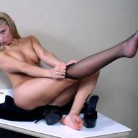 Girl Dressing Her Stockings - Blonde Hair, Glasses, Heels, Stockings