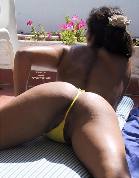 Pic #1 - Rear Shot - Black Hair, Rear View, Thong , Rear Shot, Yellow Bikini Bottom, Shot Between Her Legs, Dark Skin Brunette, Yellew Thong, Yellow Butt Floss, Laying On Stomach Legs Spread Wide, Yellow Thong, Black Hair, Rear View From Thighs And Up.