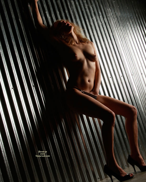 Pic #1 - Nude Girl Shadow Light - Blonde Hair, Heels, Naked Girl, Nude Amateur , Erotic Photo, Hand In Panties, Dark Shadows, Open Toed Shoes, Against The Wall, Naked On Metal Wall, Nude Girl Standing Against Wall