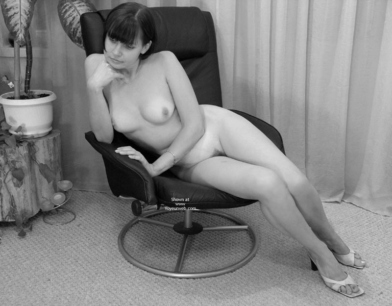 Pic #1 - Black  White - Milf , Black  White, Classic Milf, White Heels, Elbows On Arm Of Office Chair, Neatly Trimmed Landing Strip