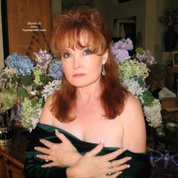 Redhead Dropping Her Bodice