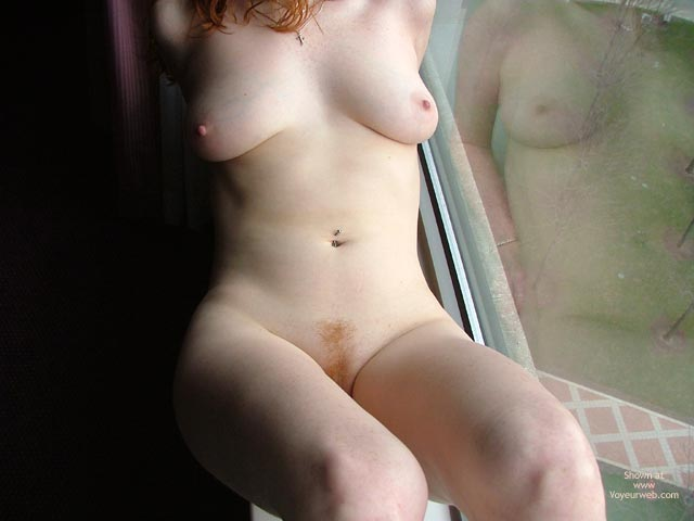 Pic #5 - Hot Redhead In Hotel Window