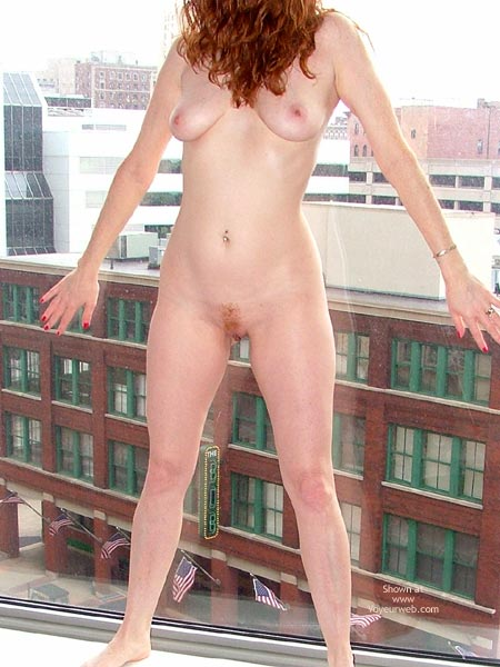 Pic #7 - Hot Redhead In Hotel Window