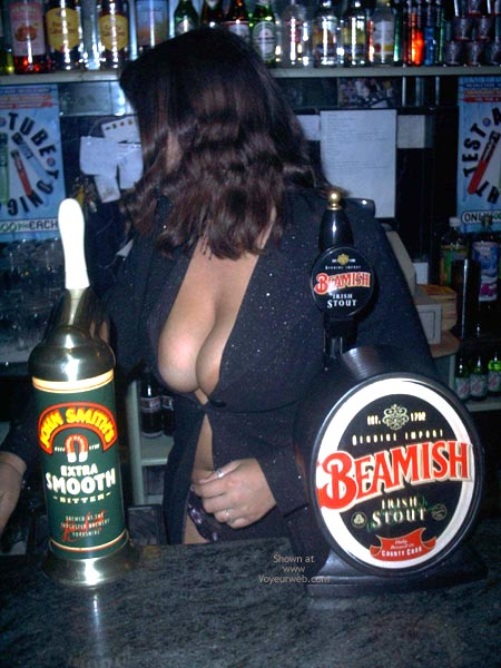 Pic #2 - A Very Busty Barmaid Flashing At Work
