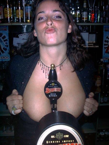 Pic #4 - A Very Busty Barmaid Flashing At Work