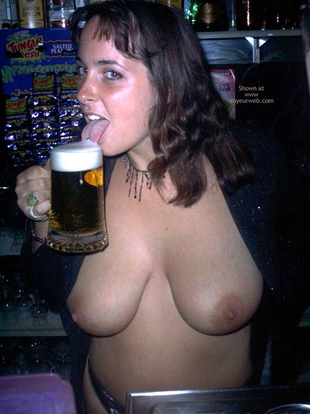 Pic #5 - A Very Busty Barmaid Flashing At Work