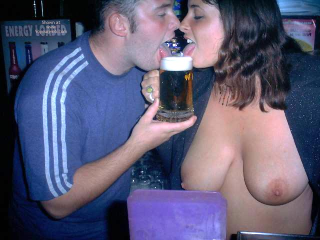 Pic #6 - A Very Busty Barmaid Flashing At Work