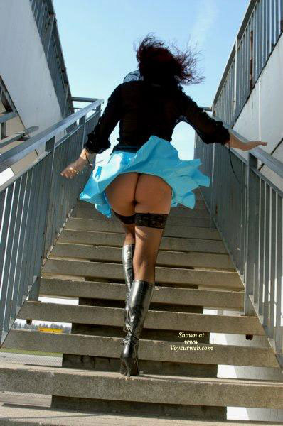 Upskirt girl on stairs