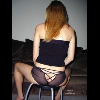 Rear Shot Of A Seated Girl