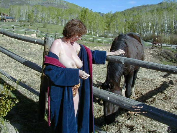 Pic #4 - Marie Topless And Feeding A Horse