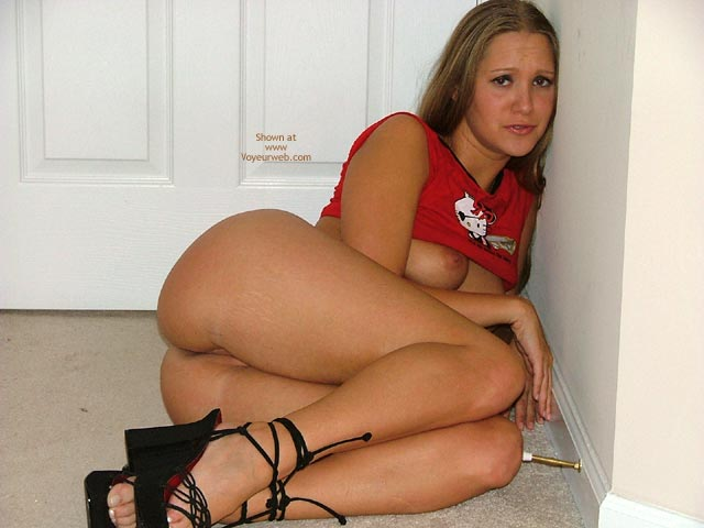 Pic #1 - Girl Lying Sideways On The Floor - Brunette Hair, Sandals , Girl Lying Sideways On The Floor, Black Sandals, Brunette Hair, Red Top, Top Lifted