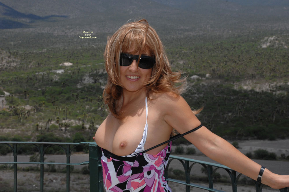 Pic #1 - Flashing Tits Outdoors - Blonde Hair, Flashing, Sunglasses, Topless , Showing Tits, Topless At Railing, Baring Breasts On Balcony, Dirty Blond Hair, White Bra With Thin Black Stripes, Floral Print Dress, Dark Sunglasses, Countryside Tits, Black Watchband, Showing Off, Arms Back, Tits Out, Showing Boobs Outdoors