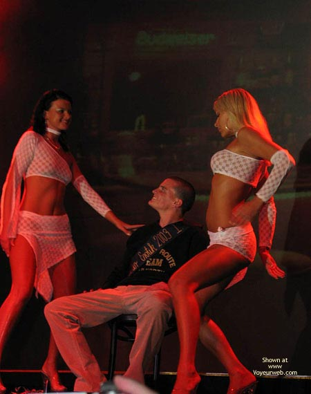 Pic #1 - Two strippers teasing one guy