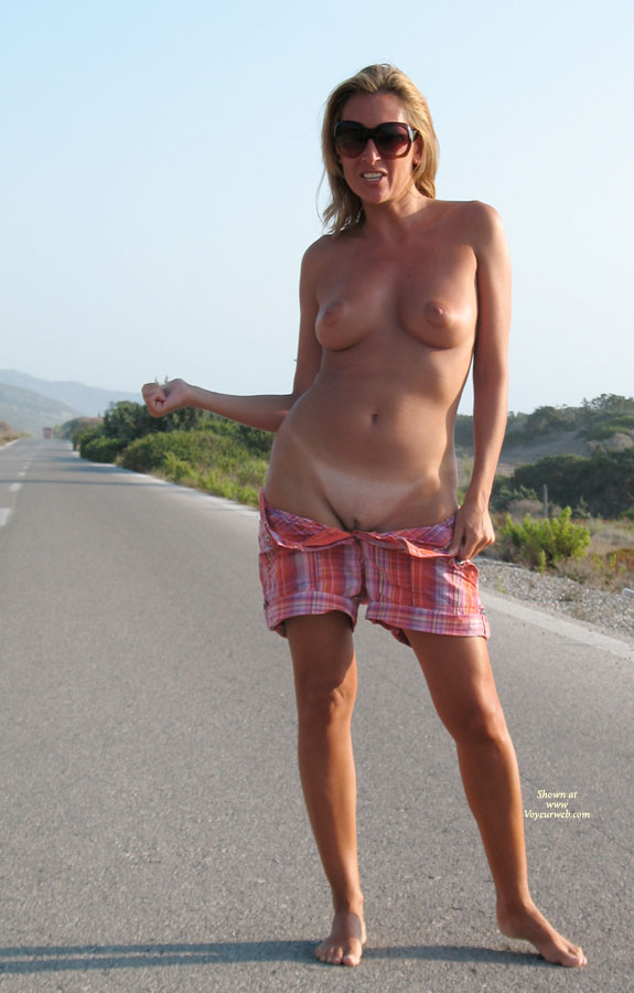 Topless Hitch Hiking With Shorts Down - Flashing, Milf, Shaved Pussy, Tan Lines, Topless , Hitchiker Flashing, Tanned Tits, Displaying Her Assets, You Want A Ride ?, Bare Feet, Hitchhicking Hottie
